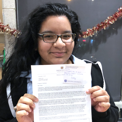 Student holding acceptance letter